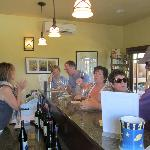 Owner Kim Grobeck attending to tasting room customers.
