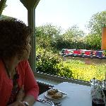 Window table view of passing boat on canal