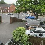 Room view showing car park and situation.