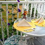 Enjoy outside patio-deck dining or dine in our sunny, cozy back porch Paradise Cafe.