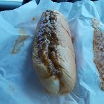 Greek dog with lots of sauce