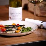 local sardines with cherry tomatoes and salsa verde