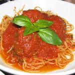 Spaghetti and Meatballs Decorated with a Touch of Green