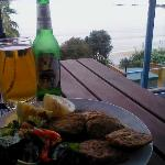 Tuatua fritters,cool beer and what a view. What more could you want
