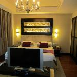 DELUXE ROOM: The room offers a 360 degree tv that swivels to either the lounge or bed.