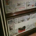 Newspaper covered hallway