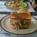 steamed veggies in rear, shrimp sandwich in front - good beer and wine