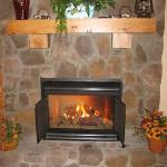 A fireplace in Green Hill Mountain room