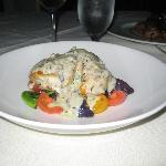Grouper with cream sauce, fiddlehead ferns, tomatoes and purple potatoes