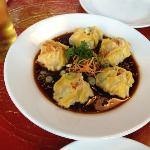 Kanom Jeep -- crabmeat, shrimp, chicken and water chestnuts in wonton skin