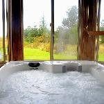 The Boreas hot tub has a single key, a candle in the window lets others know  you're in there...