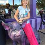 purple pig outside the pie palace