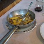 Tortelli di patate con salsiccia e funghi