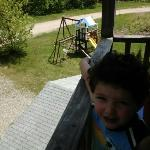 my son on our patio...below is a small play area for the kids