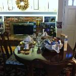 The setting of the lovely breakfast table with linen and china!