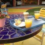 Breakfast outside near pool.