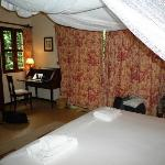 The room open to a small courtyard. There are french doors behind the curtains.