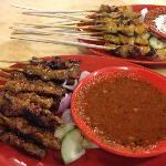 Beef and Chicken satay sticks with condiments