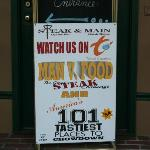 """Sign showing the """"food show"""" taped there."""