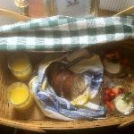 Breakfast Basket: OJ, Banana Bread, Fresh Fruit and Vanilla yogurt. Came by 8:30 each AM