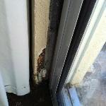 Rust on wall by door