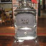 Wood burning stove in living room.  This stove was lit when we came down the stairs in the morni