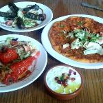 Stuffed peppers, stuffed vine leaves, lamb mince pizza bread, tzatziki dip.