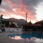 Sunset sky over the poolside at Sahin Apartments