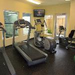 Fitness Center with view to the Indoor Pool