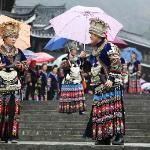 Miao villagers saying goodbye to tourists in the late afternoon