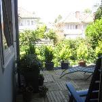 Patio door in bedroom leads to baclony/terrace overlooking gardens