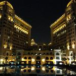 night view of the hotel +pool