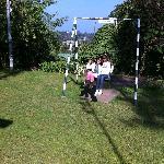 Children enjoying the swing