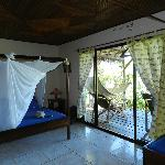 One of the rooms with a balcony with a hammock