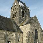 Sainte-Mere-Eglise Church– With Paratrooper hanging on roof