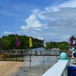 the wooden bridge connecting the resort to the beach/ kayaking/ videoke  area