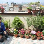 Asmita with the flowers on the fantastic terrace, good for relax...