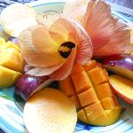 Fresh fruit and flowers at breakfast each morning
