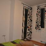 bedroom, door to balcony
