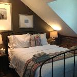 The Northern Wood's Suite is the oldest bedroom on the island, and now one of the most comfortab