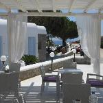 Front patio where guests gather to eat, drink, talk about their day and look at the Aegean