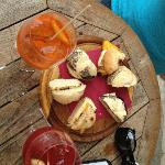 spritz con aperol (orange), cicchetti (sandwiches), spritz con select (red)