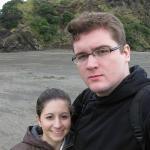 Us on the black sands of Piha Beach