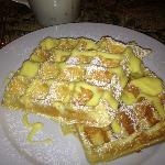 Waffles encrusted with almonds and with Lemon Sauce