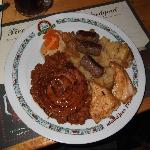 Selection of meats with potato and beans