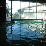 This is an indoor/outdoor pool.  Not heated like it says!