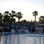 An evening business poolside event