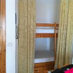 the little bunks that make up 2 of the beds, divided by curtains from the lounge/kitchen.