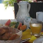 Breakfast: good coffee, fresh squeezed OJ, local fruits and french croissants and baguettes