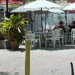 Several outdoor tables shaded by umbrellas